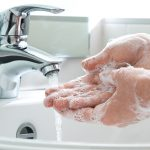 How do I best wash my hands to help prevent the spread of infection?